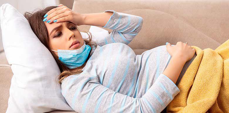 grossesse femme enceinte coronavirus co-vid 19 symptômes dangers